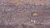 çöp : Aerial view of Garbage dump landfill. Trash trucks dump waste products polluting in a trash dump.Black birds flocks over the garbage dump. Stok Video