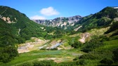 krater : Valley of Geysers. Tourist season in Kamchatka Peninsula. The summer stock footage video