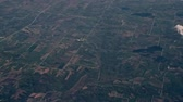 cinematic : Aerial view out of a flying passenger plane window while traveling through the united states of america.