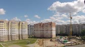 Construction of multi-storied buildings with the application of cranes.Time lapse. Vídeos