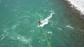 postroj : Maienfeld, GR  Switzerland - 4 August 2019: extreme sports athlete wakeboarding with ropes and harness off a bridge in the Rhine River Dostupné videozáznamy