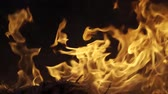 wood grill : Fire on black background in slow motion