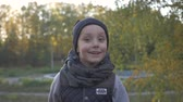 říjen : Smiling little baby boy playing in the park. Autumn. Funny cute child making vacations and enjoying Autumn.