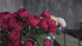 сортировать : Close up red blooming roses. Flowers at flower shop, workshop. Floristry, handmade and artwork concept