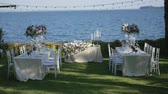ocasião : Beautiful table setting with crockery and flowers for a party, wedding reception or other festive event. On the shores of lake Garda, Italy.