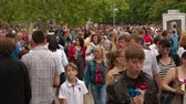 sevastopol : SEVASTOPOL, REPUBLIC OF CRIMEA - MAY 9, 2014: Huge crowd of quests and inhabitants walking along main streets after the great parade devoted to anniversary of Victory Day on May, 9 in Sevastopol.