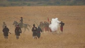 field : Horsemen and warriors fighting in the field during reconstruction of events of Alma battle of Crimea war 1984. International Military History Festival in the village Vilino of Bakhchsarai area.
