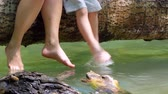 adults and childrens feet play in the water. Stock Footage