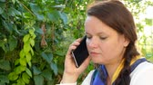 Woman talking on the phone outdoors Stock Footage
