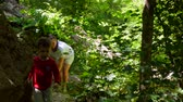 Mom and his son come back from a walk in the dense forest 動画素材