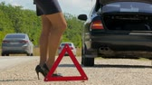 сломал : womans legs in heels walk against the warning triangle