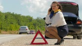 сломал : woman talking on the phone next to the warning triangle