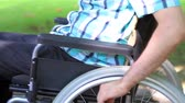 Close up of a young man in a wheelchair in the park