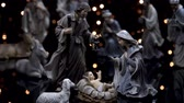 Nativity scene Christmas manger with figures and atmospheric lights. Dolly shot in 4k. Wideo