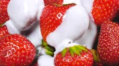 natural yogurt : Yogurt falling on fresh strawberries. Healthy breakfast concept. 4k Stock Footage