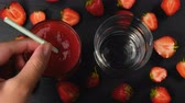 natural yogurt : Fresh strawberry smoothie flowing in glasses ready to drink. Healthy drinking concept. 4k Stock Footage