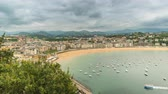 concha : High angle view of San Sebastian Concha Bay and dynamic clouds, Spain. Timelapse with vintage colors Vídeos