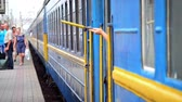 parting : Train Station, Belaya Tserkov, Ukraine - July 29, 2015.Hand holding a yellow flag sign of readiness for shipping blue train car Stock Footage