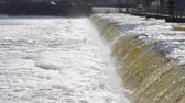 vazamento : small dam across the river close. Powerful flow of water and white foam. Ukraine