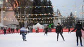 esquiador : Kiev, Ukraine, December 17, 2017: - Ice rink with many people outdoors open by day.