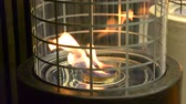 firebrand : One Biofireplace burn on ethanol gas. Contemporary mount biofuel on ethanol fireplot fireplace close-up. Modern smart ecological technologies. Interior design of a house inside