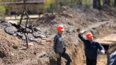 opravy : Blurred Background.Workers at the construction site, replacement of concrete slabs of a heating main. Dostupné videozáznamy