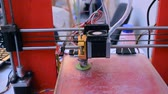 industrial revolution : 3D printer working close up. Automatic three dimensional 3d printer performs plastic. Modern 3D printer printing an object from the hot molten. Concept progressive additive technology for 3d printing.
