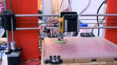 industrial revolution : 3D printer working. Fused deposition modeling, FDM. 3D printer printing an object from plastic. Automatic three dimensional 3d printer performs plastic. Progressive additive technology for 3d printing