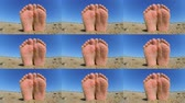 suntan : Feet legs strewn sprinkled sand sanded on sandy beach ckose-up. Wide angle. Bottom, from below. Sunny warm summer day on sandy beach near sea ocean. Rest relaxation vacation holiday weekend enjoyment Stock Footage