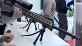 arma curta : Several large-caliber weapons on the table. Firearms gun submachine sniper rifle close-up. Vídeos