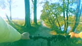 dráha : Biking on a narrow path in forest thickets. Point of view pov mtb go pro action camera.