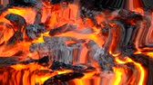 entrar : burned-out embers gray burn in the fire close-up top. Reflection in water, underwater water ripples surrealism abstract waves Stock Footage