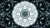 falling stars : Abstract kaleidoscope motion background. Sequence multicolored graphics ornaments patterns. Black white, Christmas New Year lace motifs sequins, falling snow. Seamless loop. Looping structure backdrop