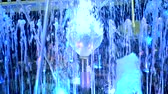 fountain show : Fountain with blue backlight. Small fountain close up at night. Stock Footage