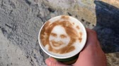 Drawing of womans face on foam coffee latte created by 3D coffe-print. 3D coffee printer created portrait of girl on foam of brewed coffee. Food ink on surface. Picture from Coffee Inkjet printer Wideo