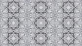 Abstract kaleidoscope motion background. Sequence graphics ornaments patterns. Gray white lace motifs sequins. Seamless loop. Looping structure backdrop Wideo