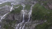 Tall waterfalls in Arhiz Russia. Epic cascade Waterfalls background. ecology Concept.
