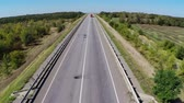 Truck driving along empty freeway in Russia. Aerial drone view. Vídeos
