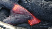 glow : Lava - flowing lava from Kilauea volcano, Big Island, Hawaii. Lava stream flowing in real-time from Kilauea volcano around Hawaii volcanoes national park, USA.