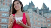 mulheres : Happy tourist woman eating Ice cream in Quebec City in front of chateau frontenac in Quebec City, Quebec Canada. Smiling joyful mixed race Asian Caucasian girl enjoying holiday travel in summer dress