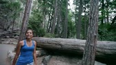 yosemite : Hiking - woman hiker Yosemite National Park forest. Fit active Asian girl walking outdoors for exercise as part of healthy lifestyle. Young mixed race Asian Caucasian female model.
