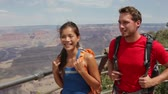 seyahat : Grand Canyon hikers hiking. Active couple walking enjoying outdoor activity hike having fun as part of healthy lifestyle. Young multiracial couple, Caucasian man, Asian woman in Grand Canyon, USA.