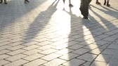 caminhada : Pedestrian commuters - shadows of people walking in city. Business people feet walking home from work. Berlin, Germany. Stock Footage