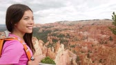 parks : Hiking - woman hiker in Bryce Canyon walking, looking and enjoying view during her hike. Bryce Canyon National Park landscape, Utah, USA. Multiracial Asian Caucasian woman living healthy lifestyle.