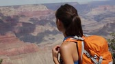 kanion : Hiking woman in Grand Canyon. Hiker walking and enjoying view of beautiful nature landscape of Grand Canyon, South Rim, Arizona, USA. Mixed race Asian Caucasian woman with view to Colorado river.