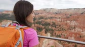 martelo : Hiking - woman hiker in Bryce Canyon walking, looking and enjoying view during her hike. Bryce Canyon National Park landscape, Utah, USA. Multiracial Asian Caucasian woman living healthy lifestyle.