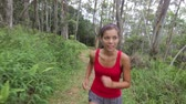 женщина : Running woman exercising jogging in forest. Female athlete runner training cross-country running on forest trail. Beautiful young fit fitness mode, mixed race Asian Caucasian in her 20s.