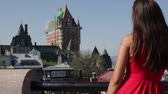tatil : Tourist woman in Quebec City, Quebec, Canada. Girl happy in front of Chateau Frontenac smiling joyful. Mixed race Asian Caucasian girl enjoying holiday travel in summer dress