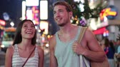 dva lidé : People in New York - happy couple on Times Square. Dating young couple in love walking and talking. Beautiful young multiracial tourists on fun date in city, Manhattan, USA. Asian woman, Caucasian man