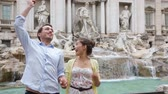 novomanželka : Travel couple throwing coin at Trevi Fountain, Rome, Italy for good luck. Happy young couple smiling traveling together on romantic travel vacation holiday in Europe. Asian woman, Caucasian man.